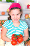 Girl with tomatoes Stock Photos