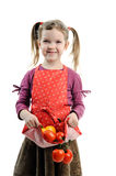 Girl with tomatoes and paprika Stock Image