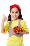 Girl with tomatoes and thumb up sign Stock Images