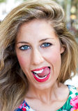 Girl with tongue on the teeeh royalty free stock images