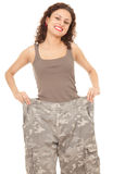 Girl in too great camouflage trousers Stock Photos