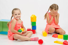The girl took the toy offending other Royalty Free Stock Photo