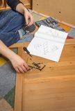 Girl with tools ready to assemble furniture Royalty Free Stock Images