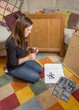 Girl with tools ready to assemble furniture Stock Image