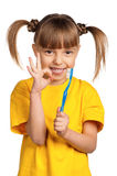 Girl with tooth brush Stock Photos