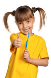 Girl with tooth brush Royalty Free Stock Images
