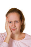 Girl with a toothache Stock Images