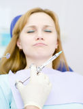 Girl with a toothache at the dentist. focus on the hand Stock Photo
