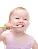 Girl with toothbrush Stock Images