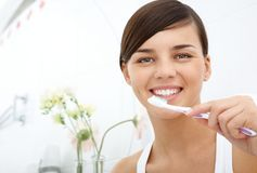 Girl with toothbrush Royalty Free Stock Photo