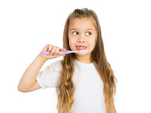 Girl and a Toothbrush. Cute gap toothed girl with her toothbrush, Isolated royalty free stock image