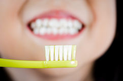 Girl with toothbrush cleaning teeth Royalty Free Stock Image
