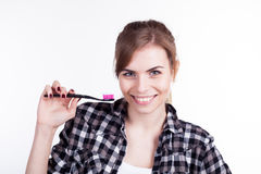 The girl with a toothbrush teeth smile. 1 Royalty Free Stock Images