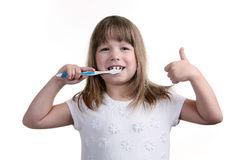 The girl with a toothbrush. On a white background Stock Image