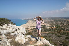 Girl at top of the cape of Greco Royalty Free Stock Photo