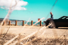Girl on top of Convertible at Half Moon Bay, California Royalty Free Stock Photos