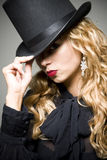 Girl with top hat Royalty Free Stock Photography