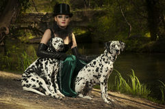 Girl in top hat. A girl in gothic outfit in the woods with the dogs Royalty Free Stock Images