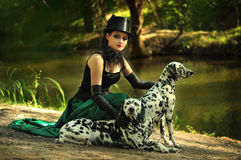 Girl in top hat. A girl in gothic outfit in the woods with the dogs Stock Images