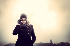 Girl on the top of high building Royalty Free Stock Image