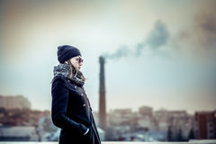 Girl on the top of high building Royalty Free Stock Photo