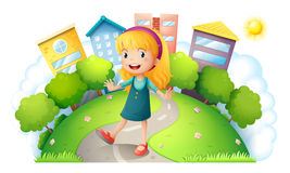 A girl at the top of the hill with buildings Royalty Free Stock Image