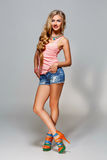 Girl in top and jeans shorts Stock Image