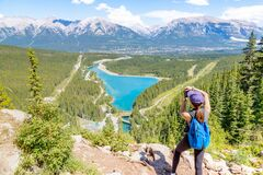 Staycation hike on top of mountain overlooking local town of Canmore and Kananaskis