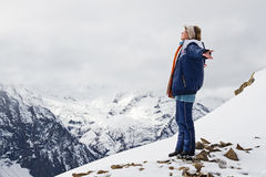 Girl top mountains snow Stock Images
