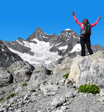 Girl on the top - Pennine Alps, Switzerland. Girl on the top, in the background mount Gabelhorn - Pennine Alps, Switzerland royalty free stock photos