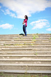 Girl on top of the steps. The dark-haired girl on top of stone stairs Stock Photography