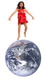 Girl on the top of the world. 8 year old girl in red dress jumping on top of the world stock image