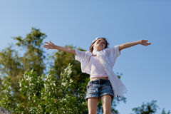 Girl on top of the world. A young girl on top of the world with her arms wide stock photo