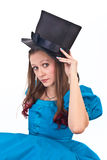 The girl in the topper. The pretty female in the topper and blue dress Stock Image