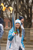 Girl torchbearer runs with torch Royalty Free Stock Photos
