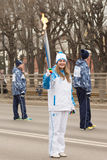 Girl torchbearer runs with torch in hand on the Paralympic Torch Stock Photography