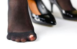 The girl in the torn shoes and black nylon pantyhose. Isolated o. N white background royalty free stock photography