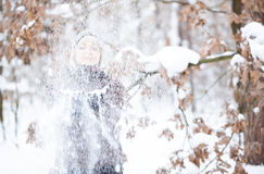 Girl tosses snow up. Royalty Free Stock Image