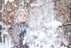 Girl tosses snow up. Stock Images