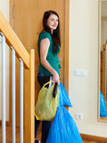 Girl tossing out the garbage at home Stock Image