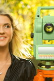 Girl and Total Station. Young Girl and Geodetic Total Station Stock Photography