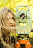 Girl and Total Station. Young girl and geodetic total station Royalty Free Stock Photography