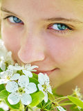 Girl touch face of flower on tree royalty free stock images