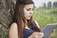 Girl with touch pad Stock Photos