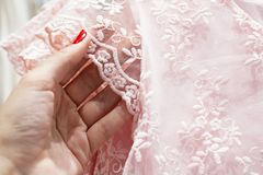 The girl touches the delicate pink lace stock photography