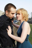 Girl touches a guy royalty free stock photography