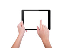 Girl touching a finger to the tablet Royalty Free Stock Image
