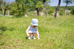 Girl Touching Grass Stock Images