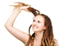 Girl touching her dreadlocks. Portrait of a caucasian girl with dreadlocks touching her hair Stock Image