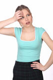 Girl touching her forehead and looking away. Close up. White background Royalty Free Stock Photo